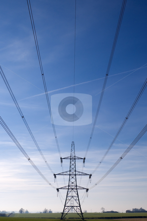 Electricity Pylons stock photo, Electricity pylon and cables stretching out into the distance across a green field by Peter Cox