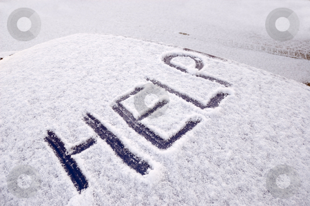 Snow covered car stock photo, Snow covered car with the word help written on the roof by Peter Cox