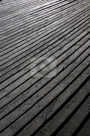 Wood effect textured plastic planks stock photo, High-density polyethylene HDPE wood effect texture planks used for decking - a polyethylene thermoplastic made from petroleum. by Peter Cox