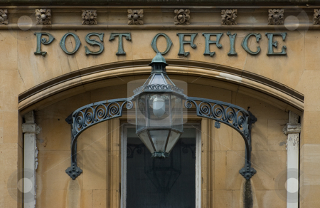 Victorian English Post Office stock photo, Entrance to an old Victorian Post Office with a wrought iron lantern decorated with scrolls and a frieze of flowers above the doorway by Peter Cox