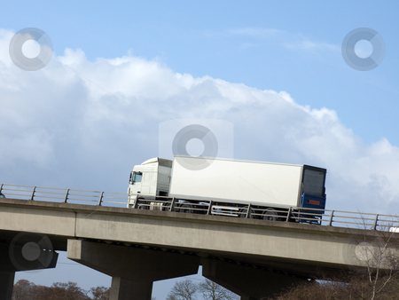 White Truck stock photo, White truck with blank copy-space heading up hill on a motorway by Peter Cox