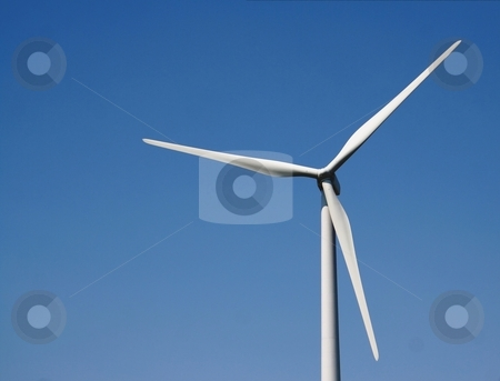 Wind Power Converter stock photo, A closeup of a windmill against a blue sky. by Chris Hill