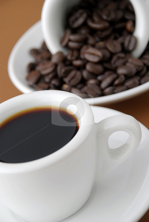 Espresso and beans stock photo, Cup of espresso and a cup of coffee beans by Paul Turner