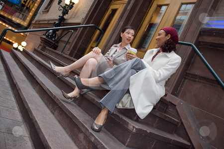 Business Women stock photo, Two business women having a casual meeting or discussion in the city. by Todd Arena