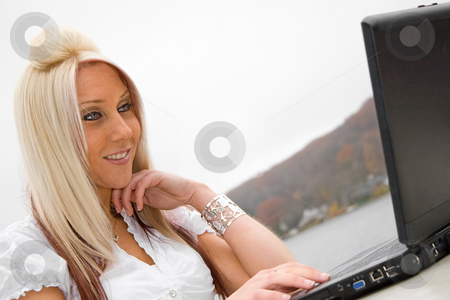 Mobile Business Woman stock photo, A beautiful young blonde woman in a mobile business setting with her laptop. by Todd Arena