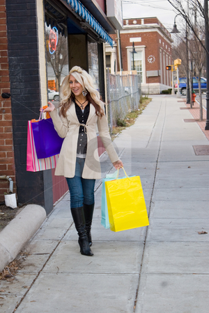 Pretty Blonde Shopper stock photo, An attractive girl out shopping in the city. by Todd Arena