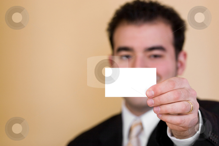 Blank Business Card stock photo, Close up of a man holding a business card up.  Plenty of copyspace for your logo or design.  Shallow depth of field. by Todd Arena