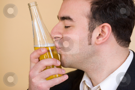 In Love With Beer stock photo, This young man really loves drinking beer. by Todd Arena