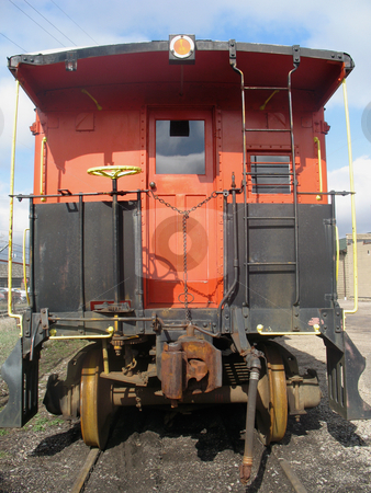 An Old Red Caboose stock photo, Old red train caboose on a train track. by Orange Line Media