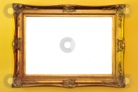 Empty picture frame stock photo, Empty gold picture frame on yellow wall by Elena Elisseeva