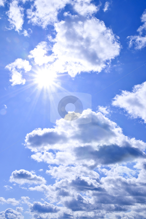 Blue sky shining sun stock photo, Background of blue sky with shining sun and clouds by Elena Elisseeva