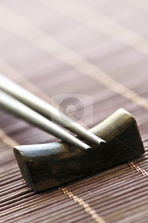 Chopsticks stock photo, Set of wooden chopsticks on rest close up by Elena Elisseeva