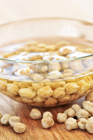 Chickpeas stock photo, Dry raw chickpeas soaking in water before cooking by Elena Elisseeva