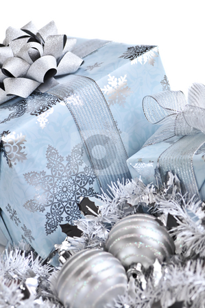 Christmas gift boxes stock photo, Wrapped gift boxes with silver Christmas ornaments on white background by Elena Elisseeva