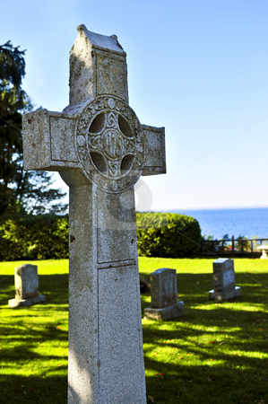 Graveyard with celtic cross stock photo, Bright graveyard lawn with ancient celtic crosses by Elena Elisseeva