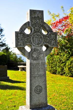 Graveyard with celtic cross stock photo, Bright graveyard lawn with ancient celtic crosses by Elena Elisseeva
