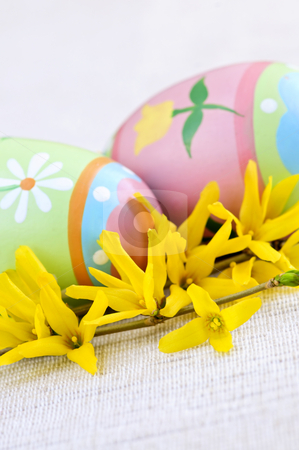 Easter eggs stock photo, Easter eggs arrangement with yellow forsythia flowers by Elena Elisseeva