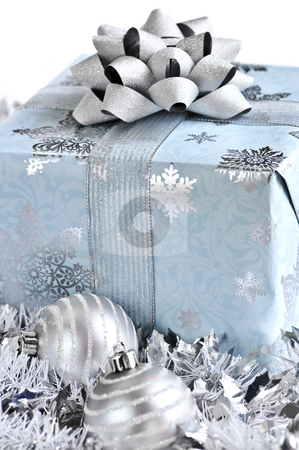 Christmas gift box stock photo, Wrapped gift box with Christmas ornaments on white background by Elena Elisseeva