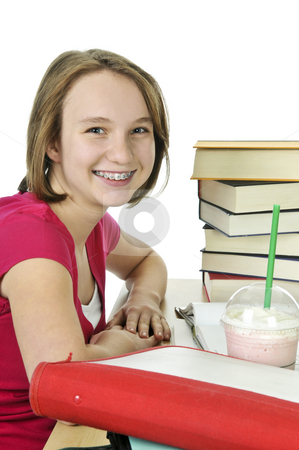 Teenage girl with milkshake stock photo, Teenage school girl studying with a milkshake by Elena Elisseeva