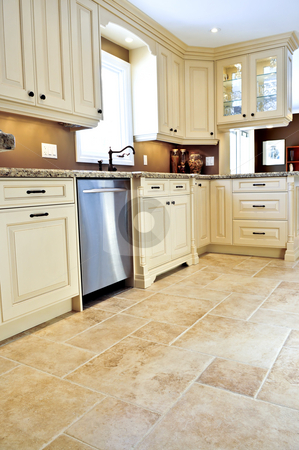 Tile floor in modern kitchen stock photo, Ceramic tile floor in a modern luxury kitchen by Elena Elisseeva