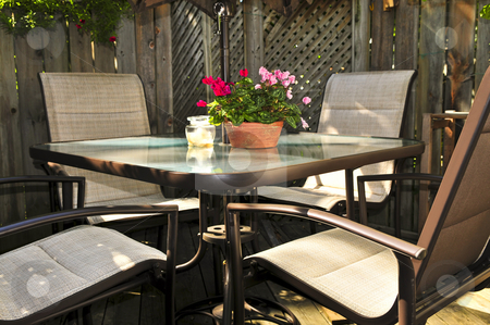Patio furniture on a deck stock photo, Wooden deck of a house with patio furniture by Elena Elisseeva