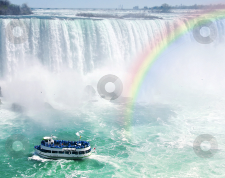 Rainbow and tourist boat at Niagara Falls stock photo, Spectacular rainbow near tourist boat at Niagara Falls by Elena Elisseeva