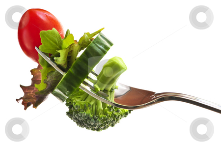 Fresh vegetables on a fork stock photo, Fresh vegetables on a fork isolated on white background by Elena Elisseeva