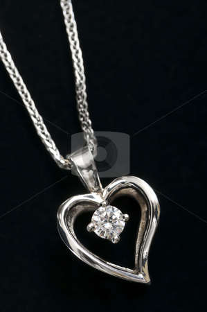 Diamond heart necklace stock photo, White gold heart pendant with diamond on a chain by Elena Elisseeva
