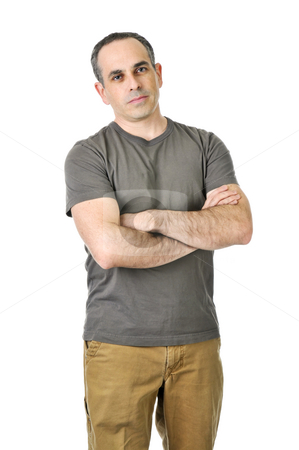 Stern father with crossed arms stock photo, Disappointed father stares with his arms crossed by Elena Elisseeva