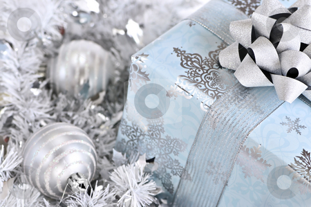Christmas gift box stock photo, Wrapped gift box with silver Christmas ornaments by Elena Elisseeva