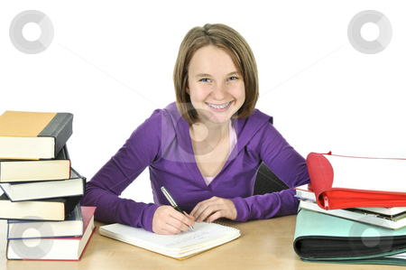 Teenage girl studying stock photo, Happy teenage girl studying at the desk by Elena Elisseeva