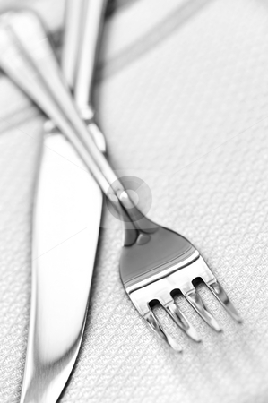 Fork and knife stock photo, Fork and knife close up on white napkin by Elena Elisseeva