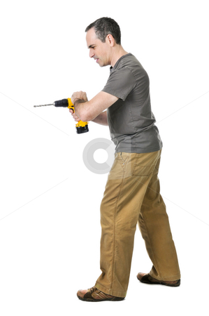 Handyman with a drill stock photo, Strong handyman pushing on his cordless drill by Elena Elisseeva