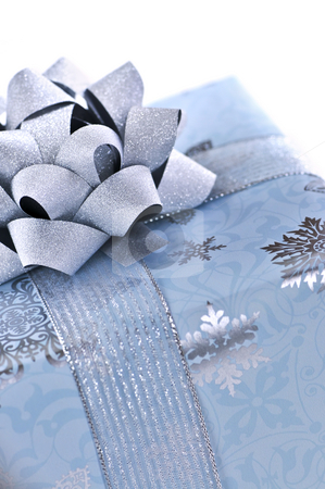 Christmas gift box stock photo, Wrapped christmas gift box close up on white background by Elena Elisseeva