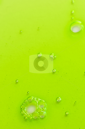 Abstract background with green liquid stock photo, Abstract green gel liquid background with bubbles by Elena Elisseeva