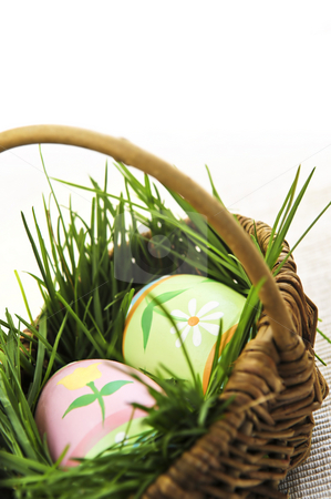Easter eggs with green grass stock photo, Easter eggs arrangement with green grass in a basket by Elena Elisseeva