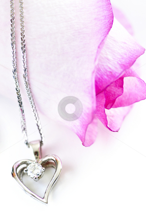 Diamond necklace on rose stock photo, Heart pendant with diamond with a pink rose by Elena Elisseeva