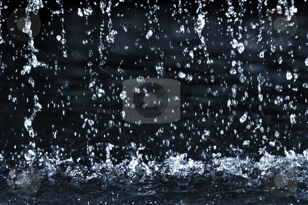 Falling water stock photo, Falling water drops on dark background close up by Elena Elisseeva