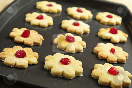 Cookies stock photo, Fresh shortbread cookies on a baking tray by Elena Elisseeva