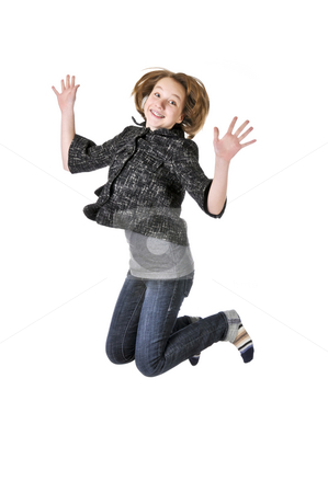 Teenage girl jumping on white background stock photo, Teenage girl jumping isolated on white background by Elena Elisseeva