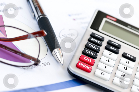Tax calculator pen and glasses stock photo, Calculating numbers for income tax return with glasses pen and calculator by Elena Elisseeva