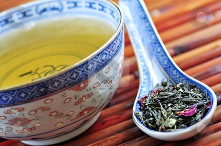 Green tea stock photo, Cup of green tea with loose dry leaves in a spoon by Elena Elisseeva