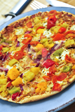 Vegetarian pizza stock photo, Freshly baked vegetarian pizza with sweet peppers by Elena Elisseeva