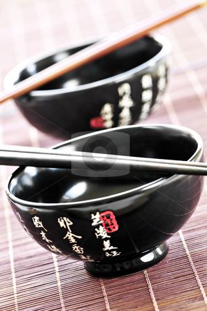 Rice bowls and chopsticks stock photo, Two rice bowls and chopsticks close up by Elena Elisseeva