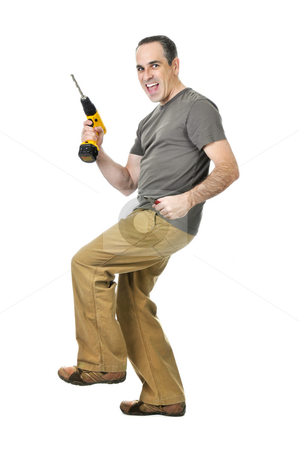 Handyman with a drill and wire cutters stock photo, Happy handyman doing a dance with his drill by Elena Elisseeva
