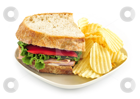 Sandwich and potato chips stock photo, Sandwich with potato chips isolated on white background by Elena Elisseeva