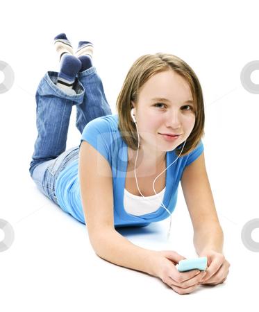 Teenage girl listening to music stock photo, Teenage girl listening to music with her mp3 player by Elena Elisseeva