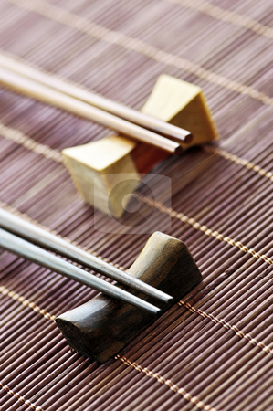 Chopsticks stock photo, Two sets of wooden chopsticks on rests close up by Elena Elisseeva