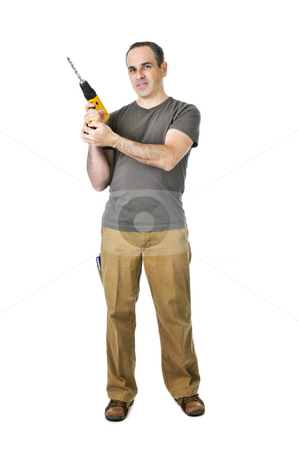 Handyman with a drill stock photo, Confident handyman ready to work holding a drill by Elena Elisseeva