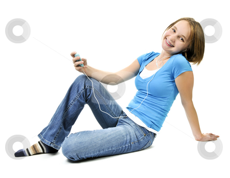 Teenage girl listening to music stock photo, Teenage girl listening to music with her mp3 player by Elena Elisseeva